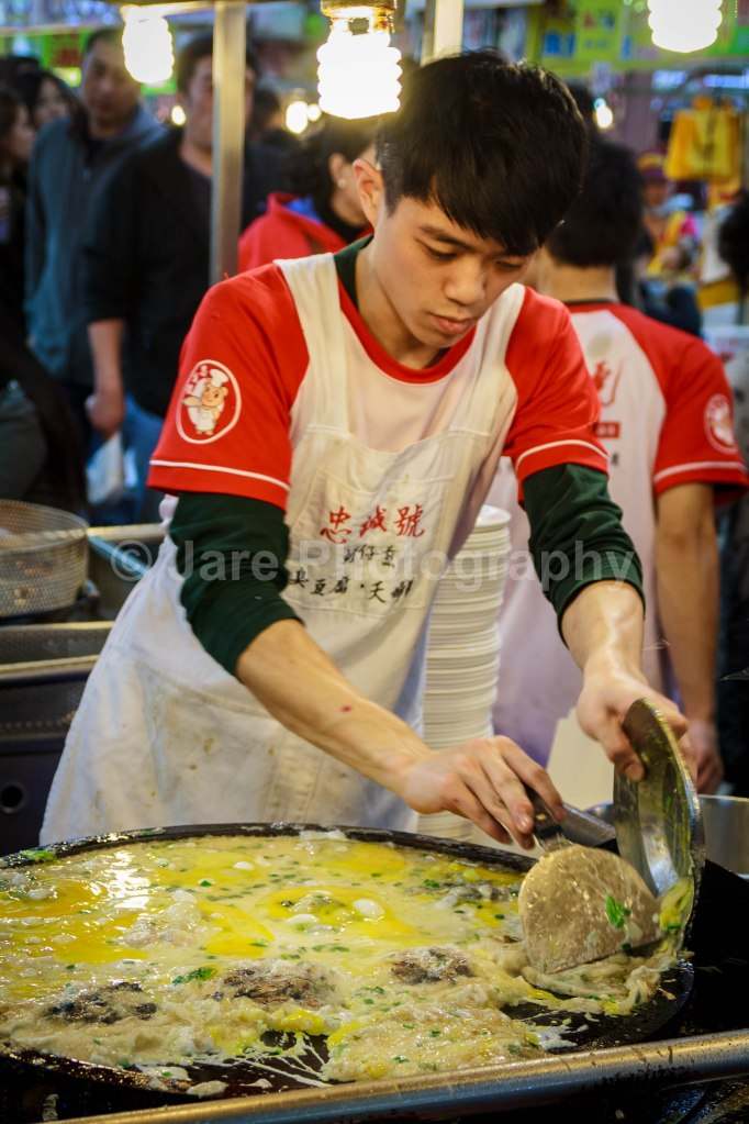 That huge pile of egg is actually several orders of Oyster Omelette...